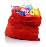 与圣诞节玩具的圣诞老人红色袋子 免版税库存图片