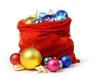 与圣诞节玩具的圣诞老人红色袋子 免版税库存照片