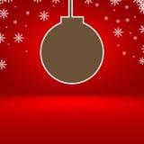 与圣诞节球的抽象红色梯度背景 库存照片