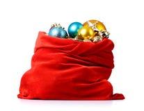 与圣诞节的圣诞老人红色袋子在空白背景戏弄 库存图片