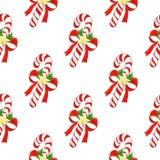 与圣诞节的无缝的假日样式镶边了棒棒糖,弓,金黄星,在水彩绘的霍莉叶子  免版税库存图片