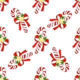 与圣诞节的无缝的假日样式镶边了棒棒糖,弓,金黄星,在水彩绘的霍莉叶子  库存图片