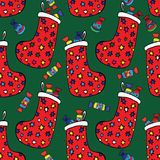 与圣诞节礼物的袜子 免版税库存图片