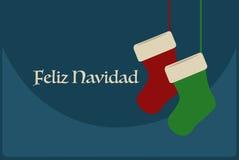 与圣诞节袜子的Feliz Navidad海报 库存照片