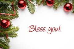 与圣诞节装饰的背景与问候`保佑您! ` 库存图片
