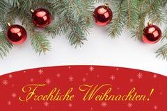 与圣诞节问候的圣诞节装饰在德国` Froehliche Weihnachten! ` 免版税库存图片