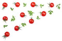 与在与拷贝空间的白色背景隔绝的荷兰芹叶子的樱桃小蕃茄您的文本的 顶视图 平的位置 免版税库存照片