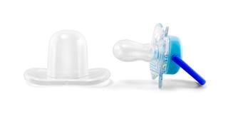 与在与道路的白色隔绝的透明防护塑料盖帽的乳汁安慰者 图库摄影