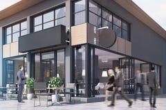 与在周围和一个长方形标志,人们的咖啡馆 库存图片
