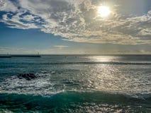 与在样式安排的云彩的太阳毛里求斯 免版税图库摄影