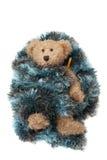 与在毯子包裹的流感病残的玩具熊 库存照片
