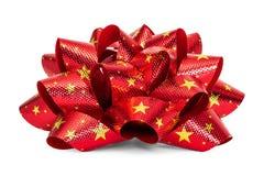 与在白色背景隔绝的特征模式的红色弓 礼物盒的美丽的丝带 库存照片