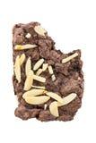 与在白色背景隔绝的叮咬的果仁巧克力 库存照片