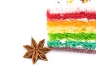 与在白色背景隔绝的彩虹蛋糕的八角 库存照片