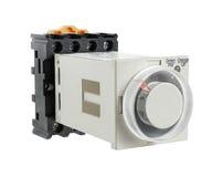 与在白色背景隔绝的插口的固体定时器 库存照片
