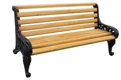 与在白色背景隔绝的生铁腿的长木凳 免版税库存照片