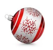 与在白色背景隔绝的雪花的红色圣诞节球 免版税图库摄影