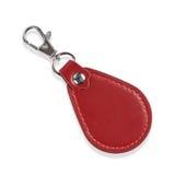 与在白色钥匙的隔绝的夹子锁的皮革圆的Keychain 库存图片