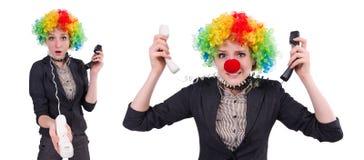 与在白色隔绝的小丑假发的商人 库存图片