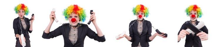 与在白色隔绝的小丑假发的商人 图库摄影