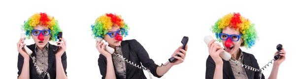 与在白色隔绝的小丑假发的商人 库存照片