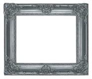 与在白色隔绝的被雕刻的装饰品的变成银色的木制框架 图库摄影
