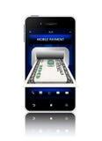 与在白色隔绝的手机的美元钞票 免版税库存照片