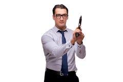 与在白色隔绝的枪的年轻商人 免版税图库摄影