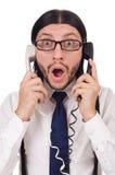 与在白色隔绝的电话的商人 免版税库存图片