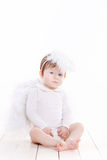 与在白色隔绝的翼的小天使 图库摄影