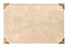 与在白色隔绝的角落的老照片纸 脏的纸板 免版税库存照片