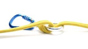 与在白色隔绝的绳索的Carabine 免版税库存图片