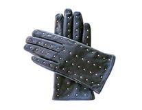 与在白色backgro隔绝的金属铆钉的黑皮手套 图库摄影
