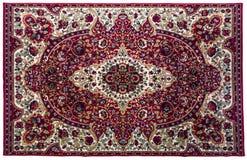 与在白色backgroun隔绝的东方装饰品的五颜六色的地毯 免版税库存图片