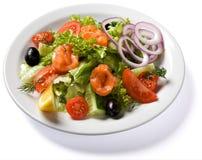与在空白牌照服务的三文鱼的沙拉 库存照片