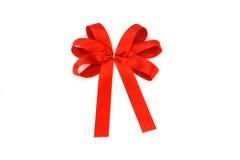 与在空白背景查出的弓的红色丝带 库存照片