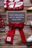 与在红色-装饰的德国文本的德国圣诞快乐卡片, 库存图片