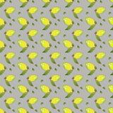 与在美好的样式的灰色背景隔绝的绿色叶子的黄色柠檬果子 库存例证