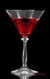 与在黑背景隔绝的鸡尾酒的残破的玻璃 免版税库存图片