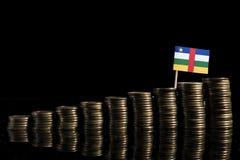 与在黑色隔绝的全部的中非共和国旗子硬币 免版税库存图片