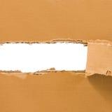 与地方的被撕毁的纸板板料文本的 库存图片