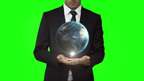 与地球动画的商人在绿色屏幕前面 影视素材