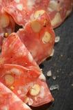 与坚果的意大利蒜味咸腊肠 库存图片