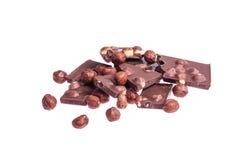 与坚果的残破的巧克力 图库摄影