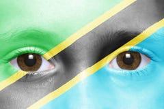 与坦桑尼亚的旗子的面孔 免版税库存照片