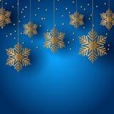 与垂悬的雪花的圣诞节背景 库存照片