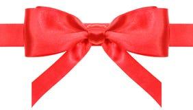 与垂直的相称红色弓在丝带结束 库存图片