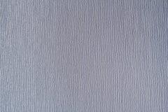 与垂直线的白色织地不很细墙纸 库存照片