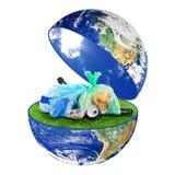 与垃圾的行星地球在白色背景 免版税库存照片
