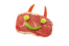 与垫铁和眼睛的微笑的使有大理石花纹的牛肉 免版税图库摄影